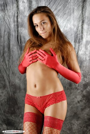 Solo girl in long crimson gloves eventually exposes her magnificent pussy