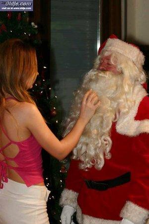 White slut sucks on Santa's toes before giving him a cum swallowing oral job