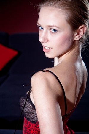 Barefoot blonde woman Katy D reveals her boobs wearing red gloves