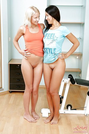 Youthfull lesbians Betsy & Malaya playing with adult toys in the gym