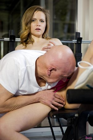 Cute blonde with tiny tits on her knees sucking oldman cock at the gym