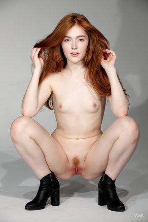 Skinny redhead Jia Lissa uncovers her tiny tits and cute donk as she gets naked