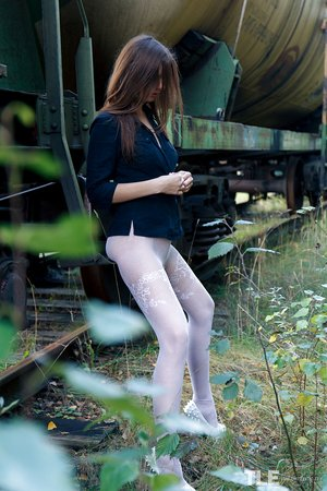Brunette in stockings Rebeka Ruby toys herself while taking a piss outdoors
