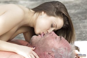 Flexible young girl performs fellatio on an old boy after doing yoga