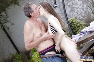 Sexy youthful girl squatting naked for oldman ball tonguing session outdoors