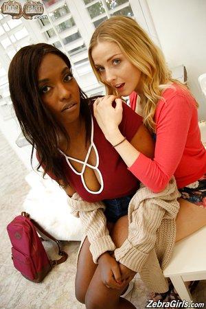 Blonde Karla Kush uses strapon to teach Ebony Daya Knight sing and moan