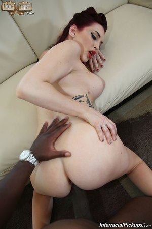 Redhead pinup model Amber Ivy heads hardcore with a big ebony dick