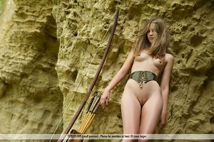 Blonde teen Nastya H heads nude and barefoot while bow hunting