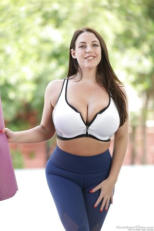 Curvaceous solo girl Angela White unleashes her hangers while doing yoga