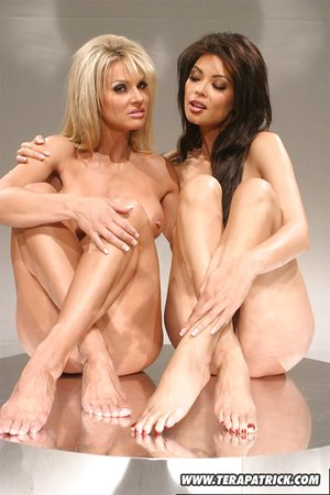 Sexy naked lesbians pose seductively while touching nipples in bare feet