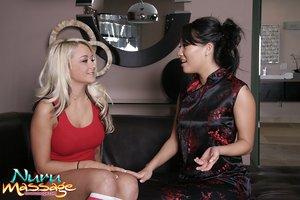 Sexy Asa Akira massages Briana Blair's oiled big tits leading to tribbing play