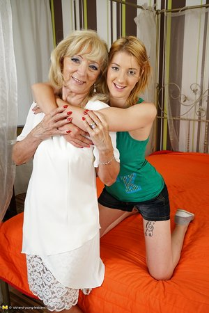 Horny granny and a barely legal teen girl engage in lesbian sex acts