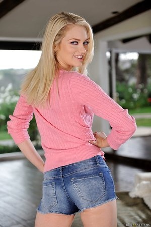 Blonde with hot feet Alli Rae displays her perfect curves in the living room