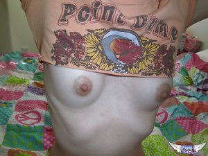 Young amateur girl takes selfies while revealing her small boobies and snatch