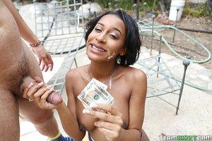 Barely legitimate black woman Jazzy Jamison taking cum shot on face for money