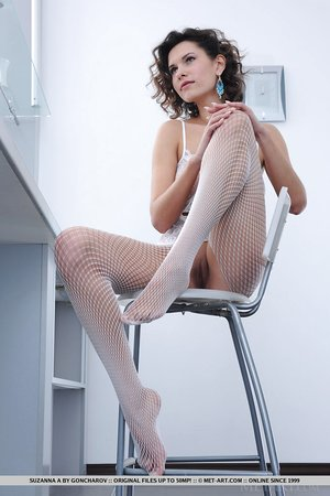 Erotic babe Suzanna A in tights undressing to spread legs broad open