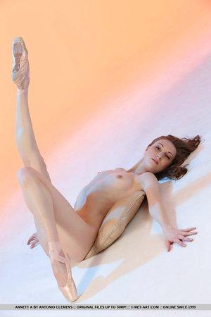 Flexible hot redhead Annett A in short dress & pantyhose spreading pussy wide