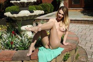 Naughty teem girl Blake Eden fucktoys her pussy in garden wearing crotchless hose