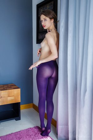 Stunning youthful Clarice A slowly peels her sexy pantyhose to reveal her wee ass