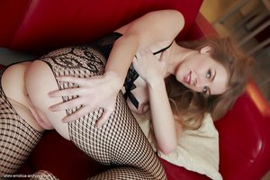 Teen solo girl Larissa shows off her pretty pussy in a crotchless bodystocking