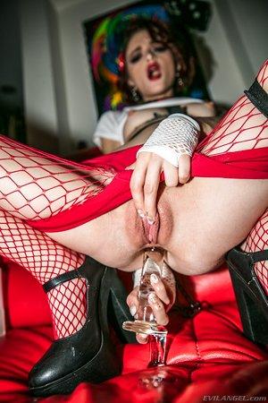 Horny tattoo artist Lola Fae fucks her asshole with a huge glass dildo