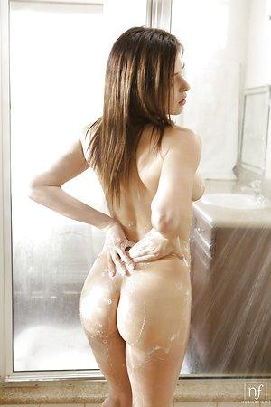 Teen pornstar Leah Gotti wetting perfect tits and masturbating in shower