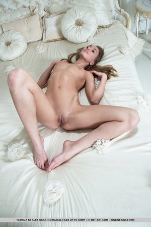 Leggy young woman Tayra A shedding dress for wide open sight of perfect pussy