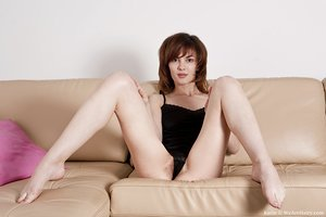 Cute little Karin shows off her ideal body and pets her taut fuzzy pussy