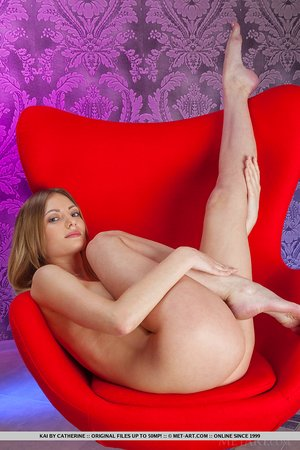 Blond model Kai in sexy lingerie showing off perky knockers & bald muff barefoot