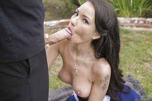Sexy little dame with tattoos jerking cock outdoors for cum swallowing