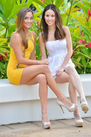 Leggy lesbos in high heels flash no panty upskirts outside and smooch on lips