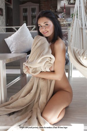 Gorgeous brunette Sarah J bares nice big tits & sheds white thong undies