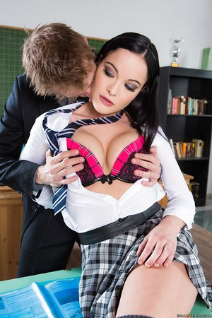 Brown-haired schoolgirl Dolly Diore goes stripped to the waist in class before sex with teacher
