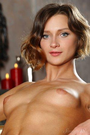 Beautiful brown-haired Doris G doffs undressing to show big nipples & bald beaver