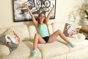 Cute babe Lilly Ford licks her sexy toes while masturbating on the sofa