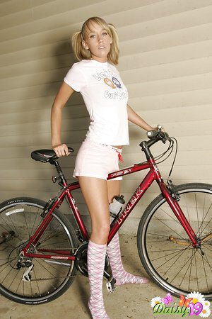 Cute blonde teenage cyclist Daisy in ponytails flashing her killer wet perfect mounds