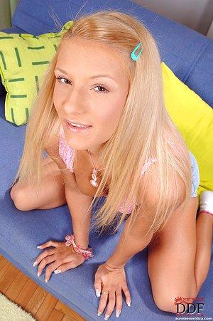Sweet blonde Eve Jordan removes cotton underwear to toy teen pussy in socks