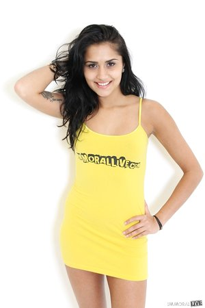 American girl Giselle Mari takes off her yellow dress to stand naked
