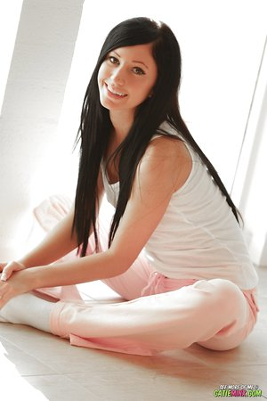 Smiling teenage girl Catie Minx plays with her pussy in white socks