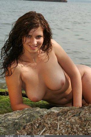 Fair skinned brunette chick Mari Ann flaunts her fat naturals by the ocean