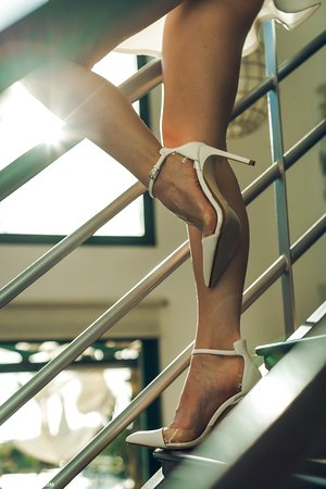 Wonderful upskirt Lyuda flashes her sexy panties while posing on the stairs