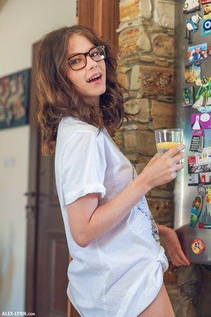 Teen glamour model with splendid glasses Hilary loves baking butt naked