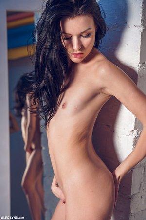 Leggy brunette female Elousie admires her nude form in a mirror