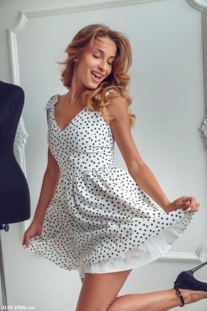 Naked teen girl Cara Mell pulls on a pair of black heels and a summer dress