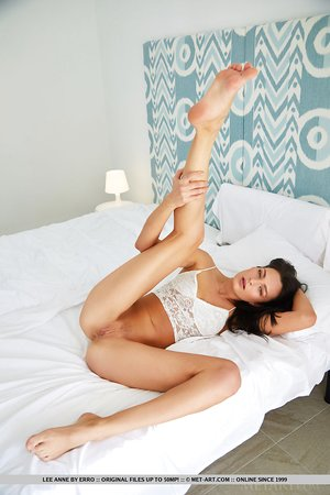 Long legged brunette Lee Anne draws attention to her taut slit