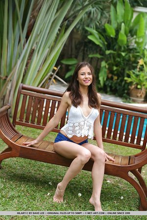 Brunette teen Hilary C flaunts her skinny body on bench in backyard