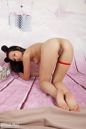 Tiny dark haired teen Lada strips off her cute garment and shows innocent crevices
