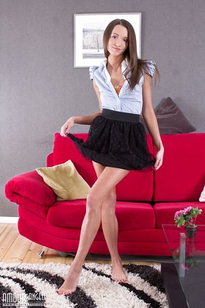 Playful teen Britney strips down on the sofa and opens her legs broad