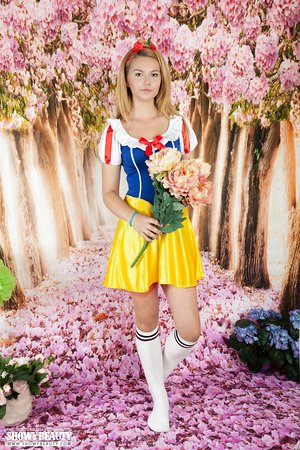 Cosplay girl Pop sheds Snow White costume to show nude twat in knee socks