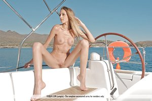 Skinny blond teen Stina poses naked on a sailboat anchored in the harbour